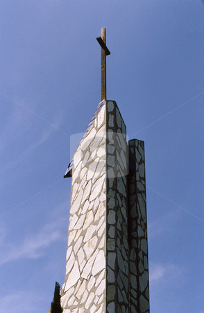 Church tower stock photo, Church tower of unusual design and shape with cross by Joseph Ligori