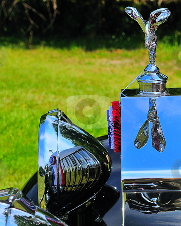 Flying lady stock photo, Rolls royce flying lady reflected on radiator and headlamp by Tim Doubrava