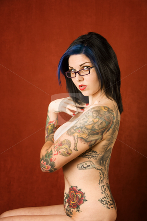 Woman with tattoos stock photo, Pretty young woman with many tattoos on her back and arms by Scott Griessel