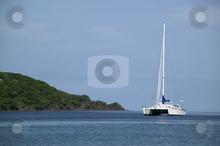 Catamaran on the Horizon stock photo, Expensive catamaran off shore on the horizon by Scott Griessel