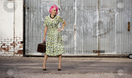 Woman with Pink Hair and a Small Siuitcase stock photo, Woman with pink hair in an alley with small suitcase by Scott Griessel