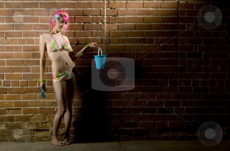 Woman in a bikini on brick stock photo, Pretty woman in a flowered bikini on a brick background by Scott Griessel