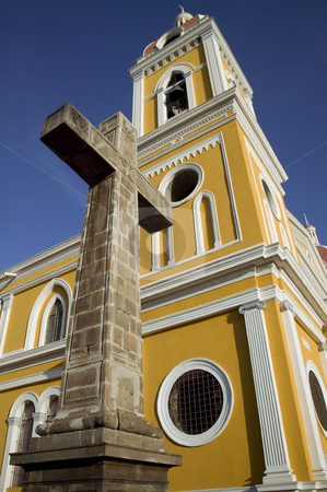 Cathedral de Granada Nicaragua stock photo, Stone cross next to the yellow cathedral in central Granada Nicaragua by Scott Griessel