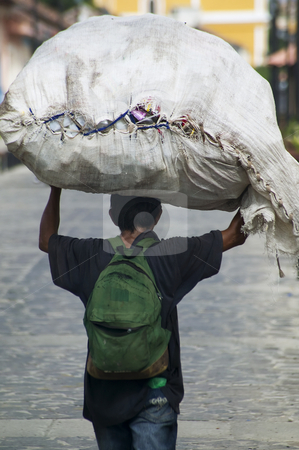Nicaraguan man with a large burden stock photo, Nicaraguan man carrying a large package on his head by Scott Griessel