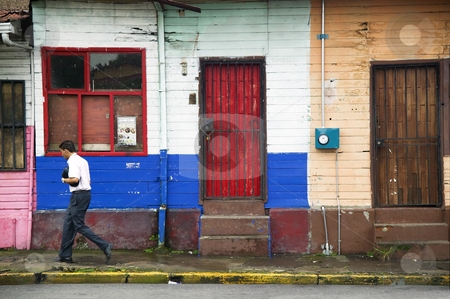 Alajuela Costa Rica street scene stock photo, Colorful buildings and man on the street in Alajuela Costa Rica by Scott Griessel
