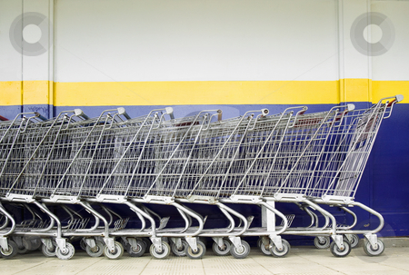 Line of Shopping Carts stock photo, Line of old style shopping carts outside a supermarket by Scott Griessel