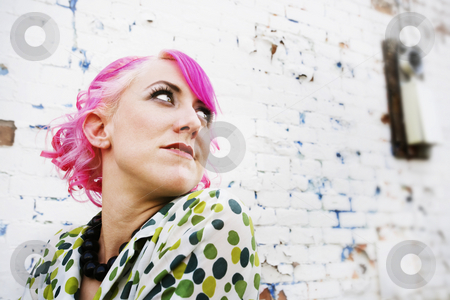 Pretty Woman with Pink Hair stock photo, Woman with pink hair wearing polka dot dress in alley by Scott Griessel