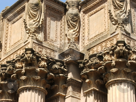 Palace of Fine Arts Colonade stock photo, Built in 1915 as part of the Panama-Pacific International Exposition, San Francisco's Palace of Fine Arts rotunda and exhibition hall was so well received with its Roman design and Greek decorations that the temporary structure became a permanant fixture.  Here the Greek style decordations on the top of the collanades are shown up close. by Dennis Thomsen
