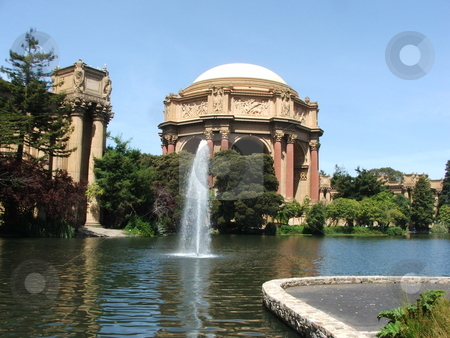 Palace of Fine Arts stock photo, Built in 1915 as part of the Panama-Pacific International Exposition, San Francisco's Palace of Fine Arts rotunda and exhibition hall was so well received with its Roman design and Greek decorations that the temporary structure became a permanant fixture.  Greek style decordations on the top of the collanades are visible on the top portion of the rotunda. by Dennis Thomsen