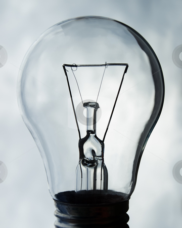 Light bulb off stock photo, Light bulb turned off and cloudly sky represent energy crisis. by Sinisa Botas