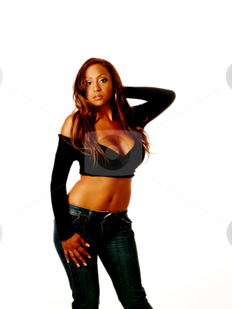 Woman posing stock photo, Young woman in black sweater blue jeans bare stomach by Jeff Cleveland