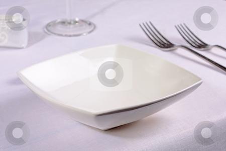 White china bowl in an elegant restaurant place setting stock photo, White china bowl in an elegant restaurant place setting by Mark Allchin