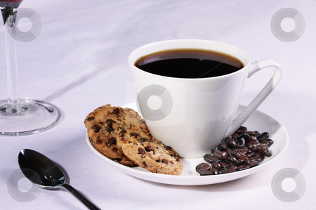 Coffee cup with biscuits and Coffee beans stock photo, Coffee cup in a restaurant setting with biscuits and Coffee beans by Mark Allchin