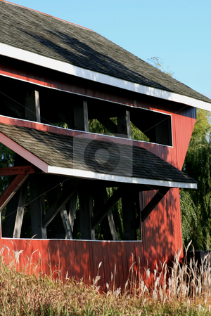 Close up covered bridge stock photo, Close up side view of a 1800's covered bridge. by Betty Hansen