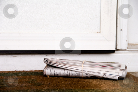 Newspaper stock photo, A freshly delivered Sunday morning early edition newspaper. by Robert Byron