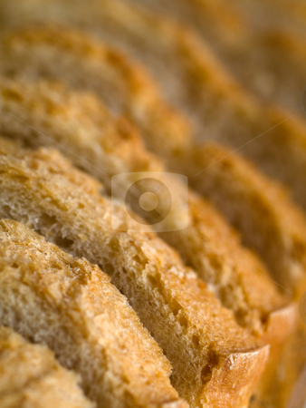 Bread slices stock photo, French countryside bread slices with shallow depth of field by Laurent Dambies