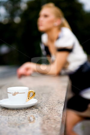 Beautiful young woman and coffee stock photo, Blond lovely young woman drinking coffee outside by Vitaly Sokolovskiy