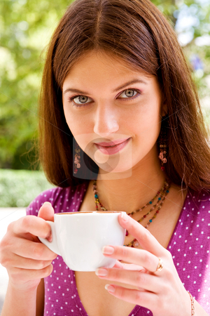 Beautiful young woman and coffee stock photo, Smiling lovely young woman drinking coffee outside by Vitaly Sokolovskiy