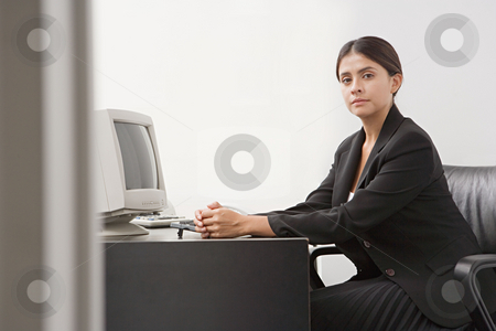 Businesswoman in her office stock photo, Businesswoman in her office by Mpixis World