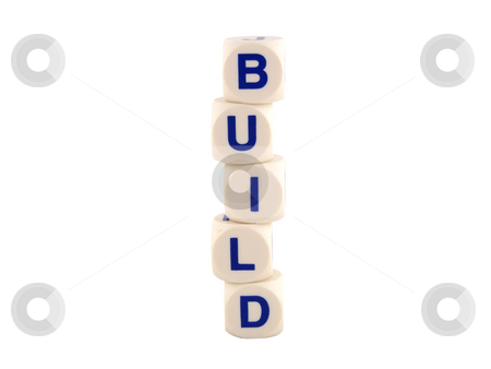 Build Blocks stock photo, Building blocks isolated on a white background by Adrian Mace