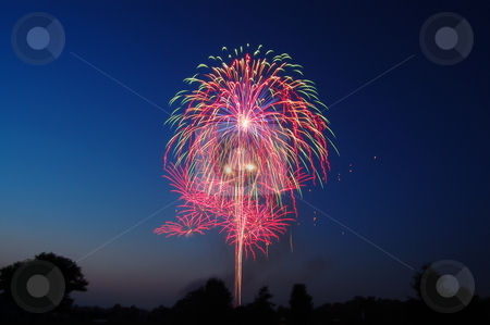Colorful fireworks at Twilight stock photo, Fireworks in Goshen, Indiana, USA by Heather Shelley