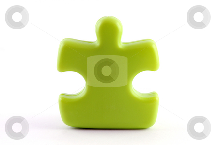 Puzzle piece stock photo, One green puzzle piece isolated on white by Csaba Zsarnowszky