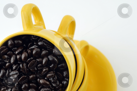 Cups with coffe beans stock photo, Three yellow cups with coffe beans isolated on white by Csaba Zsarnowszky