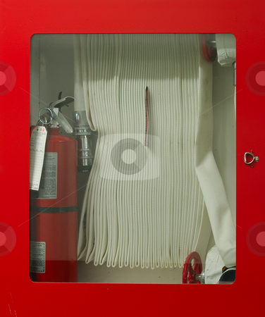 Fire Hose stock photo, Fire Hose and extinguisher in Glass Cabinet by Will Burwell
