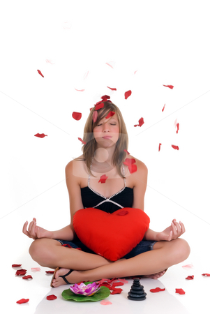 Girl with Zen stones stock photo, Young attractive girl with Zen stones and lotus flower.   Studio shot, reflective surface by Patrick Hermans