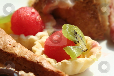 Dessert pastries stock photo, Dessert fruit cups and pastries on white plate by Kheng Guan Toh