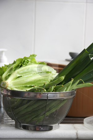 Fresh vegetables stock photo, Fresh raw green leafy vegetables washed in collander by Kheng Guan Toh
