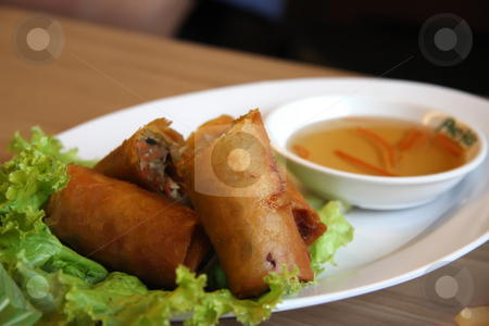 Vietnamese springrolls stock photo, Fried vietnamese spring rolls with traditional greens by Kheng Guan Toh