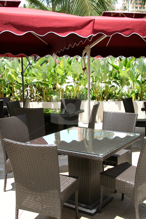 Poolside cafe stock photo, Tropical poolside outdoor cafe with umbrellas by Kheng Guan Toh