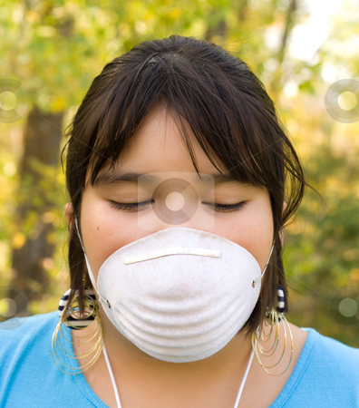 Dust Mask stock photo, A nine year old girl wearing a dust mask outside by Richard Nelson