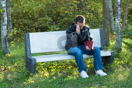 Headache stock photo, A man sitting on a park bench with a head ache by Richard Nelson