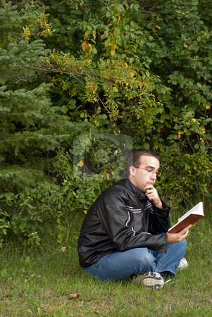 Peace and Quiet stock photo, A man reading a book outside alone in some peace and quiet by Richard Nelson