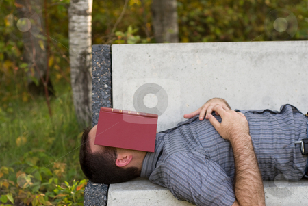 Sleeping Beauty stock photo, A man having a nap on a park bench by Richard Nelson