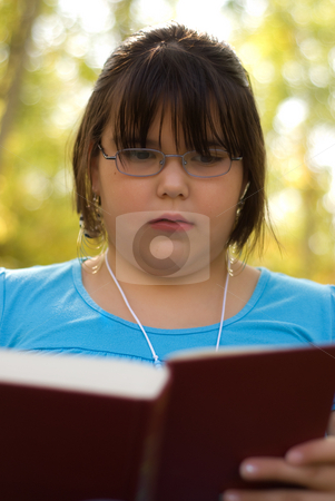 Knowledge stock photo, A nine year old girl studying from her text book for school by Richard Nelson