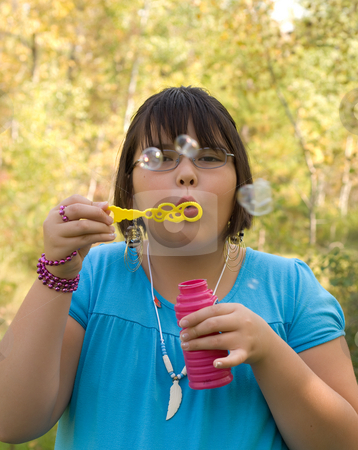 Outdoor Fun stock photo, Nine year old girl blowing bubbles outside by Richard Nelson