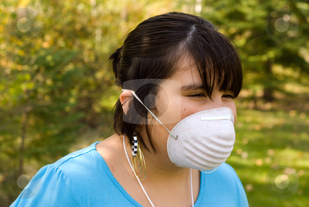 SARS stock photo, A young girl wearing a mask to protect herself from SARS by Richard Nelson
