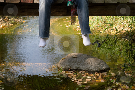 Dangling Feet stock photo, A pair of dangling feet hanging off a bridge by Richard Nelson