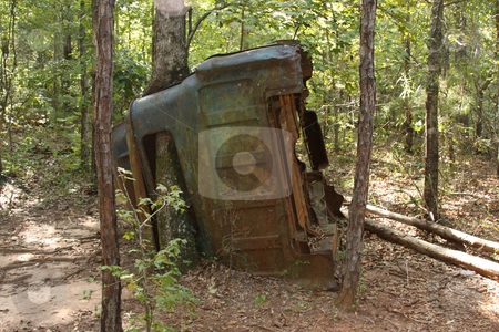 Old Truck stock photo, I thought the tree growth was pretty neat. by George Botta
