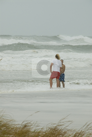 Gustav Lifeguard Warning stock photo, PENSACOLA - SEP 1: A lifeguard warns a man that the surf is too dangerous during Hurricane Gustav on September 1, 2008.  Gustav claimed the lives of more than 130 people. by A Cotton Photo
