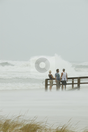 Gustav Hanging On stock photo, Spectators hang on in the high surf and wind during Hurricane Gustav on September 1 2008. Gustav winds reached a max of 150mph. by A Cotton Photo