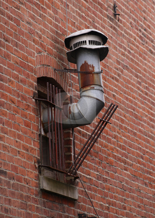 Furnace Vent Pipes stock photo, Old furnace vent pipes protruding out of a window and the security bars, by Betty Hansen
