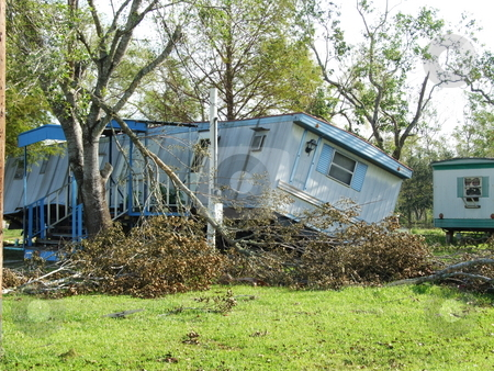 Hurricane Damaged Mobile Home stock photo, Hurricane Ike's 105 mile per hour winds pushed this mobile home off its foundation and onto its side. by Marburg