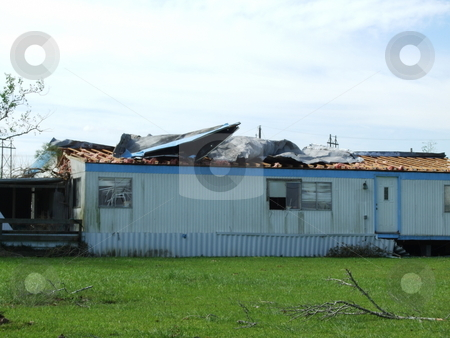 Hurricane Damaged House stock photo, The roof was torn up on this house due to tornado after Hurricane Ike by Marburg