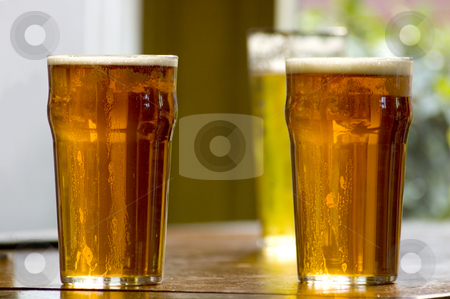 Pub Beer stock photo, Typical pub seen with beer in the foreground by Lee Torrens