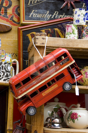 Model of a London Bus stock photo, Toy model of a typical London bus in an antique store window by Lee Torrens