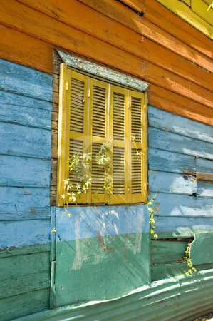 Exterior wall and window in La Boca Buenos Aires stock photo, A colorfully painted exterior wall of a building in the historic area of La Boca in the Argentinean capital Buenos Aires by Lee Torrens